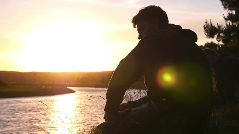 Man on a River Bank